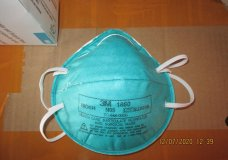 This December 2020 image provided by U.S. Immigration and Customs Enforcement (ICE) shows a counterfeit N95 surgical mask that was seized by ICE and U.S. Customs and Border Protection. Federal investigators are probing a massive counterfeit N95 mask operation sold in at least five states to hospitals, medical facilities, and government agencies and expect the number to rise significantly in coming weeks. The fake 3M masks are at best a copyright violations and at worst unsafe fakes that put unknowing health care workers at grave risk for coronavirus. And they are becoming increasingly difficult to spot. (ICE via AP)