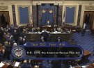 n this image from video, the vote total of 50-49 on Senate passage of the COVID-19 relief bill, is displayed on screen in the Senate at the U.S. Capitol in Washington, Saturday, March 6, 2021. (Senate Television via AP)