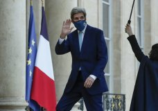 United States Special Presidential Envoy for Climate John Kerry waves as he arrives at the Elysee Palace in Paris, Wednesday, March 10, 2021, to meet French President Emanjuel Macron. Kerry traveled to Paris to relaunch transatlantic cooperation with European officials in the wake of President Joe Biden's decision to rejoin the global effort to curb climate change. (AP Photo/Michel Euler)