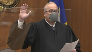 In this image from video, Hennepin County Judge Peter Cahill swears in the jury, Monday, March 29, 2021, in the trial of former Minneapolis police officer Derek Chauvin, in the May 25, 2020, death of George Floyd at the Hennepin County Courthouse in Minneapolis, Minn. (Court TV via AP, Pool)