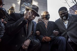 From foreground left, attorney Ben Crump, the Rev. Al Sharpton and Brandon Williams, nephew of George Floyd, take a knee for 8 minutes and 46 seconds during a news conference at the Hennepin County Government Center in Minneapolis, Minn., on the first day of the Derek Chauvin murder trial Monday, March 29, 2021. (Jerry Holt/Star Tribune via AP)