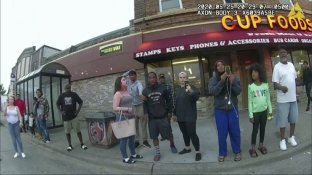 This image from a police body camera shows people gathering as former Minneapolis police officer Derek Chauvin was recorded pressing his knee on George Floyd's neck for several minutes as onlookers yelled at Chauvin to get off and Floyd saying that he couldn't breathe on May 25, 2020 in Minneapolis. From the moment a bystander filmed the incident, video shaped the public's understanding of Floyd's death. (Minneapolis Police Department via AP)