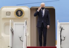 President Joe Biden salutes from the top of the steps of Air Force One at Andrews Air Force Base, Md., Tuesday, March 16, 2021, as he prepares to depart for a trip to Pennsylvania. (AP Photo/Susan Walsh)