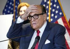 FILE - In this Nov. 19, 2020, file photo, former New York Mayor Rudy Giuliani, who was a lawyer for President Donald Trump, speaks during a news conference at the Republican National Committee headquarters in Washington. A law enforcement official tells the Associated Press that federal investigators have executed a search warrant at Rudy Giuliani's Manhattan residence. The former New York City mayor has been under investigation for several years over his business dealings in Ukraine. (AP Photo/Jacquelyn Martin, File)