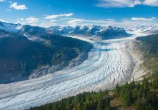 This September 2017 photo provided by researcher Brian Menounos shows the Klinaklini glacier in British Columbia, Canada. The glacier and the adjacent icefield has lost nearly 16 billion tons (14.5 billion metric tons) of snow and ice since 2000, with 10.7 billion tons of that (9.8 billion metric tons) of that since 2010, Menounos says. And the rate of loss accelerated over the last five years of the study. (Brian Menounos via AP)
