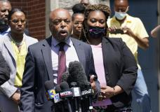 Attornys for the family of Andrew Brown, Wayne Kendall, front, and Chantel Cherry-Lassiter, right, make comments after a judges decision on the release body cam video of the shooting of Andrew Brown Jr. in Elizabeth City, N.C., Wednesday, April 28, 2021. A judge denied the request to immediately release body cam video of the incident. (AP Photo/Steve Helber)