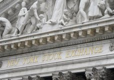 FILE - In this Nov. 23, 2020 file photo, stone sculptures adorn the New York Stock Exchange. Stocks are opening higher on Wall Street, Thursday, April 1, 2021 led by more gains in technology giants and smaller companies. (AP Photo/Seth Wenig, File)