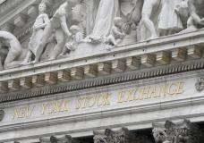 FILE - In this Nov. 23, 2020 file photo, stone sculptures adorn the New York Stock Exchange. Stocks are easing lower in early trading on Wall Street as investors absorb the latest round of company ...