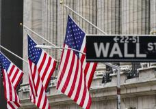 FILE - American flags hang outside of the New York Stock Exchange, in this Tuesday, Feb. 16, 2021, file photo. Stocks were edging higher in early trading Friday, April 23, but the overall market is still on pace to end the week lower for the first weekly loss in five weeks. (AP Photo/Frank Franklin II, File)