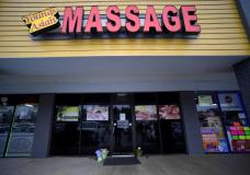 FILE-In this Wednesday, March 17, 2021 file photo, A make-shift memorial is seen outside a business where a multiple fatal shooting occurred on Tuesday, in Acworth, Ga. Robert Aaron Long, 22, accused of killing eight people, six of them women of Asian descent, in shootings at three Atlanta-area massage businesses was indicted Tuesday, May 11, 2021, on murder charges, and a prosecutor filed notice that she'll also seek hate crime charges and the death penalty. (AP Photo/Mike Stewart, File)