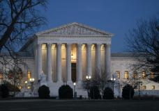 FILE - In this Jan. 22, 2020, file photo, night falls on the Supreme Court in Washington. The Supreme Court is considering whether to hear the case of a Black man who says he suffered discrimination because the N-word was carved into the wall of the hospital elevator where he worked. (AP Photo/J. Scott Applewhite, File)