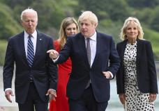 From left: US President Joe Biden, Carrie Johnson, Britain's Prime Minister Boris Johnson and First Lady Jill Biden walk outside Carbis Bay Hotel in Cornwall, Britain, Thursday June 10, 2021. (Toby Melville/Pool Photo via AP)