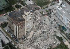 his aerial photo shows part of the 12-story oceanfront Champlain Towers South Condo that collapsed early Thursday, June 24, 2021 in Surfside, Fla. (Amy Beth Bennett /South Florida Sun-Sentinel via AP)