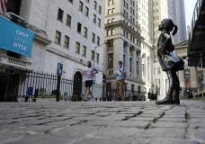 """The """"Fearless Girl"""" statue faces the New York Stock Exchange, Wednesday, June 16, 2021. Stocks are opening broadly higher on Wall Street Friday, June 25 keeping the S&P 500 on track for its biggest weekly gain since April. (AP Photo/Richard Drew)"""
