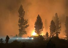 In this photo provided by the Bootleg Fire Incident Command, the Bootleg Fire burns at night in southern Oregon on Saturday, July 17, 2021. The destructive Bootleg Fire, one of the largest in modern Oregon history, has already burned more than 476 square miles (1,210 square kilometers), an area about the size of Los Angeles. The Bootleg Fire is among dozens burning in the parched West. (Bootleg Fire Incident Command via AP)