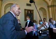 Senate Majority Leader Chuck Schumer, D-N.Y., updates reporters on the infrastructure negotiations between Republicans and Democrats, at the Capitol in Washington, Wednesday, July 28, 2021. (AP Photo/J. Scott Applewhite)