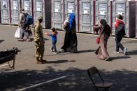 Afghanistan refugees arrive at a processing center in Chantilly, Va., Monday, Aug. 23, 2021, after arriving on a flight at Dulles International Airport. (AP Photo/Andrew Harnik)