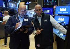 Trader Fred DeMarco, left, and specialist Meric Greenbaum work on the floor of the New York Stock Exchange, Wednesday, Sept. 15, 2021. Stocks were modestly higher in morning trading Wednesday, helped by higher energy prices which in turn pushed energy companies higher. (AP Photo/Richard Drew)