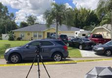 Law enforcement officials swarmed a home in North Port, Fla. on Monday, Sept. 20, 2021, in the disappearance of Gabby Petito, whose body was apparently discovered over the weekend at a Wyoming national park. The officers served a search warrant at the home of the parents of her 23-year-old boyfriend Brian Laundrie, who is wanted for questioning. (AP Photo/Curt Anderson)