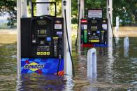 Gas pumps are submerged in water as the Schuylkill River exceeds its bank in the East Falls section of Philadelphia, Thursday, Sept. 2, 2021 in the aftermath of downpours and high winds from the remnants of Hurricane Ida that hit the area. (AP Photo/Matt Rourke)