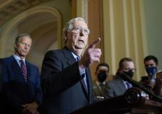Senate Minority Leader Mitch McConnell, R-Ky., joined at left by Minority Whip John Thune, R-S.D., speaks to reporters after a Republican strategy meeting at the Capitol in Washington, Tuesday, Oct. 19, 2021. (AP Photo/J. Scott Applewhite)