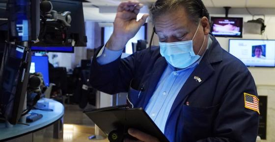 Trader John Santiago works on the floor of the New York Stock Exchange, Tuesday, Oct. 19, 2021. Stocks are moving modestly higher on Wall Street in early trading Tuesday as corporate earnings reporting gets into full swing. (AP Photo/Richard Drew)