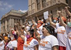 FILE- In this Wednesday, Sept. 1, 2021, file photo, women protest against Texas' restrictive abortion law at the Capitol in Austin, Texas. A federal judge on Friday, Oct. 1, 2021, will consider whether Texas can leave in place the most restrictive abortion law in the U.S., which since September has banned most abortions and sent women racing to get care beyond the borders of the nation's second-largest state. (Jay Janner/Austin American-Statesman via AP)