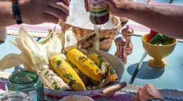 Summer Grilling Recipes - Grilled Corn with Chipotle Butter recipe by Pints & Plates featured on frostedevents