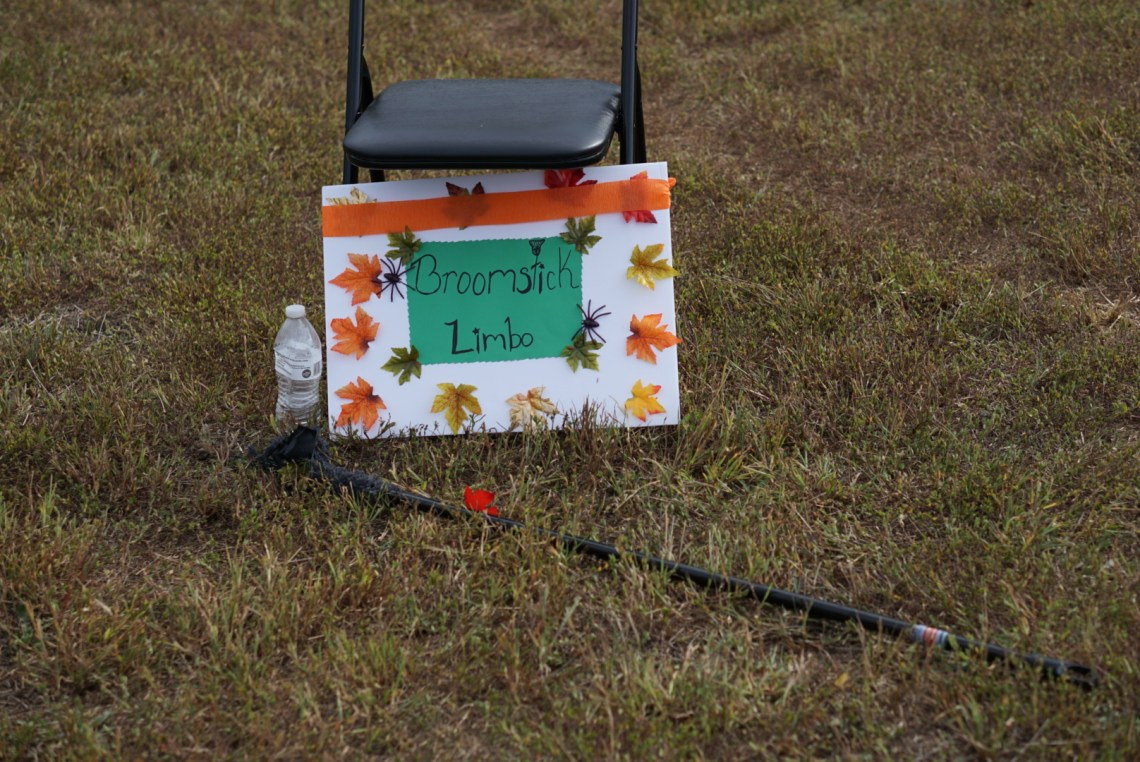 Halloween Games for Kids - Broomstick Limbo - Fun Kids Games via Misty Nelson, mom blogger @frostedevents