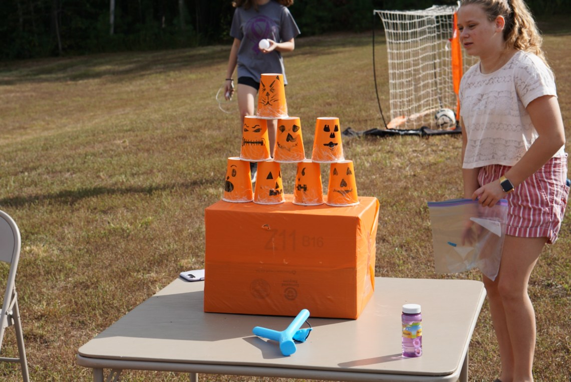 Halloween Games for Kids -Witchs Hat Glow Stick Toss - Fun Kids Games via Misty Nelson, mom blogger @frostedevents
