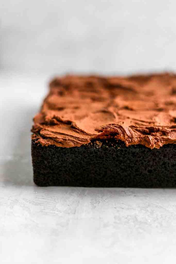 Swirls of chocolate buttercream on a one bowl chocolate cake.