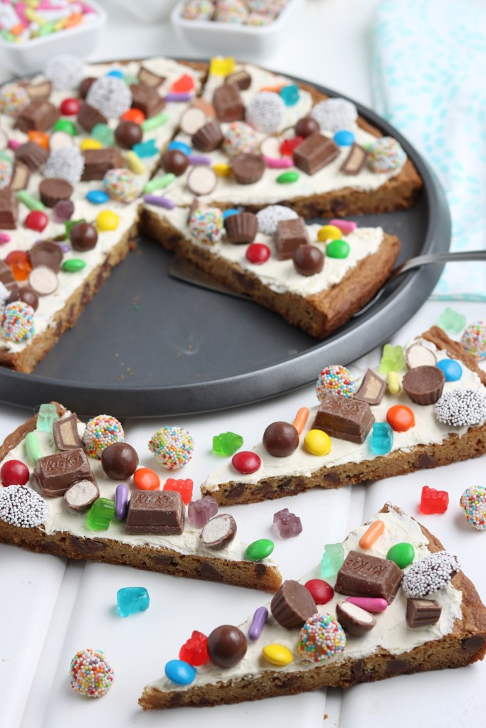 easy cookie pizza recipe cut into slices and topped with candy