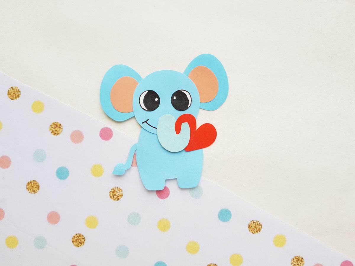 Blue elephant papercraft on polka dot paper
