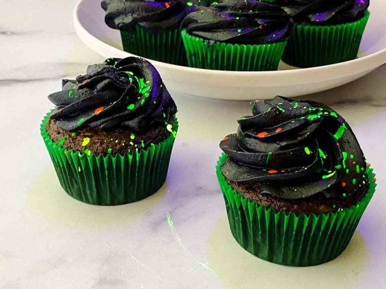 glow in the dark cupcakes with green, pink and yellow splatters