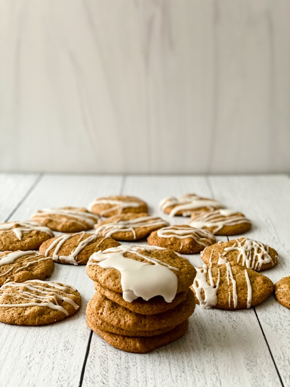 stack of brown butter cookies with other in the background