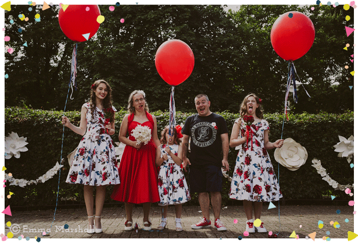 wedding family and giant red balloons