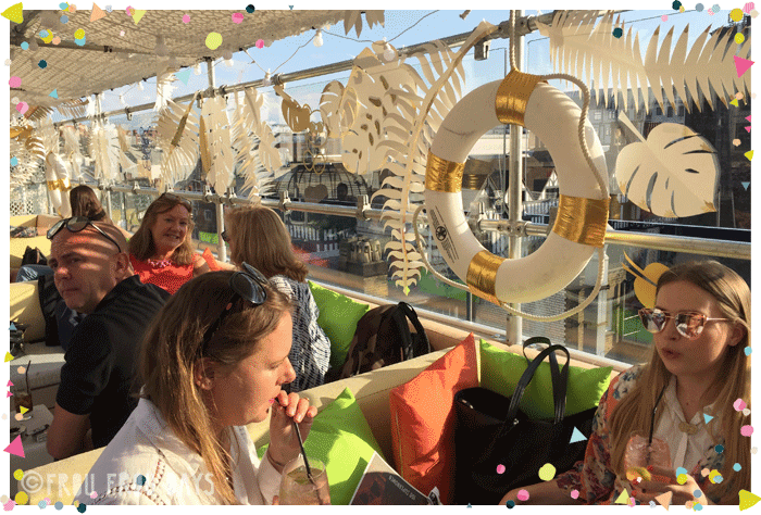 Hazel May corporate Summer rooftop party giant white and gold palm leaves