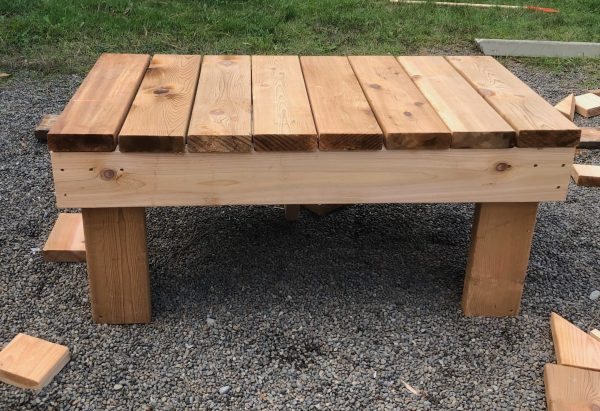 Mud kitchen base frame - cedar decking boards 2x6 on top of a base frame outdoors in backyard