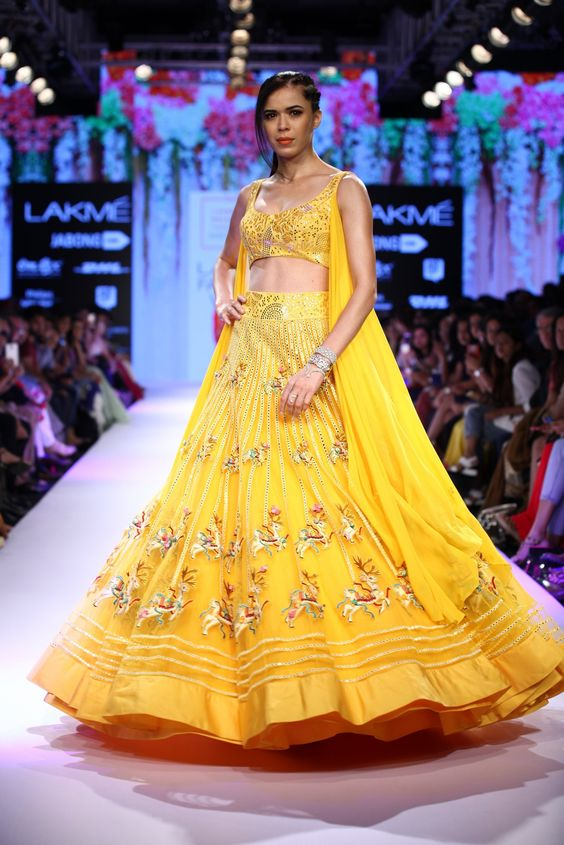 a model at the Lakme fashion week in a yellow lehenga