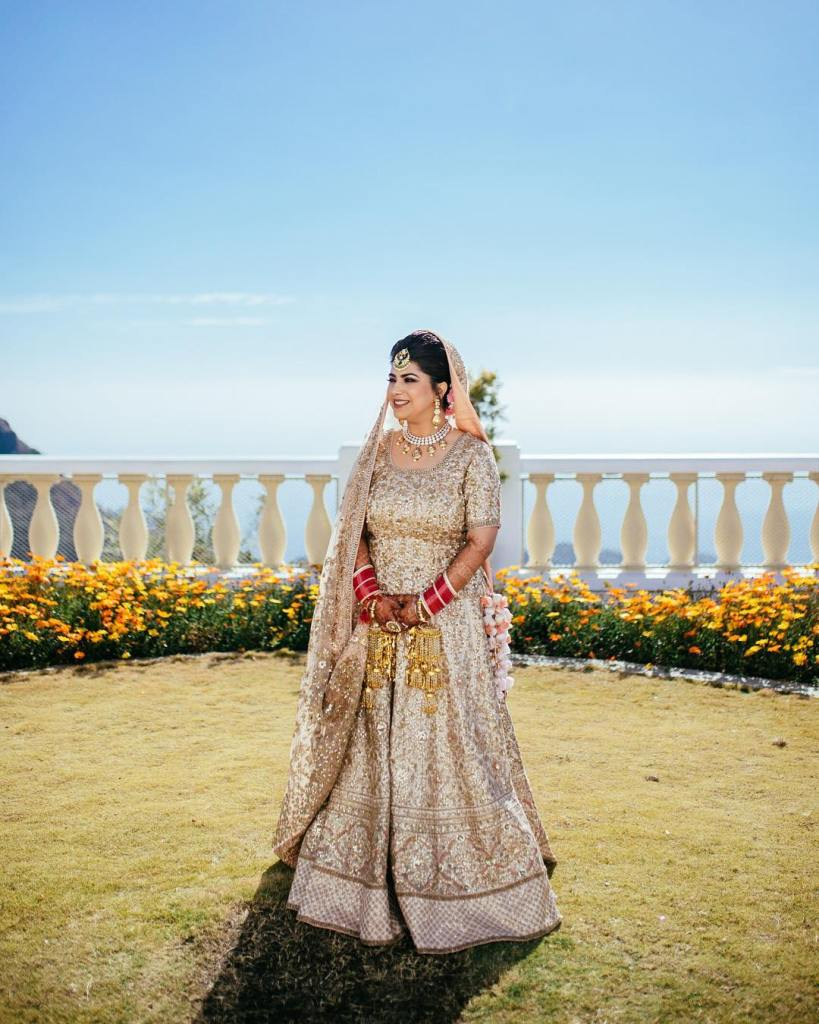 Bride in Gold Lehenga