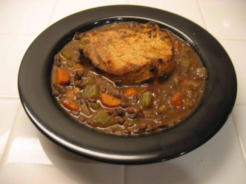 Grilled pork chop on aduki bean stew