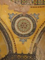 fresco images on a wall yellow paint