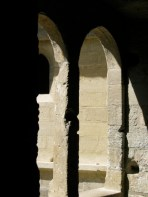 stone columns in a courtyard in the sunshine