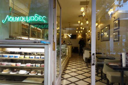 Entrance to a traditional Athens dairy bar with Greek yoghurt in the window