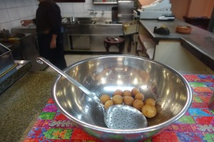 Loukoumades in a stainless steel bowl