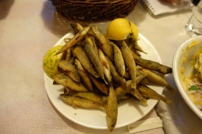 Greek whole fried fish on a plate