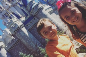 Kids in front of castle at Disney World - A Frugal Mom's Guide To Disney - 10 Ways To Save At Disney