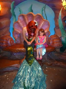 Little girl with Ariel at Disney World attraction - A Frugal Mom's Guide To Disney - 10 Ways To Save At Disney