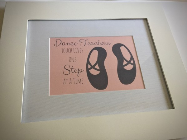 "Dance teacher gift print in frame that reads "" Dance teachers touch lives one step at a time"" - Tutu-riffic Gifts For Dancers & Dance Teachers With Printable Gift Tags"