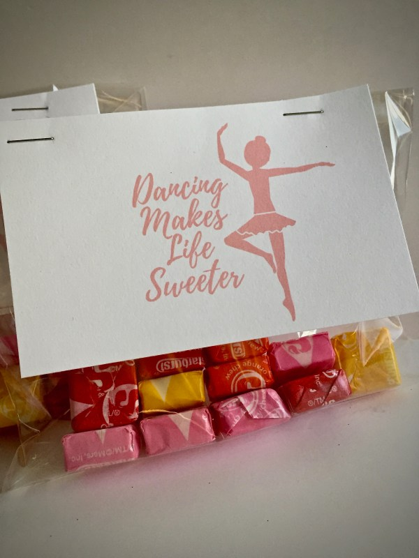 "Bag of candy with gift tag that reads ""Dancing Makes Life Sweeter"" - Tutu-riffic Gifts For Dancers & Dance Teachers With Printable Gift Tags"
